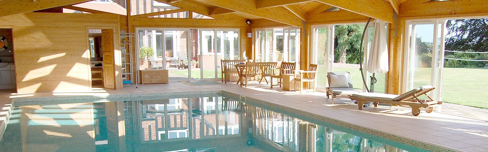 Indoor swimming pools buckland pool reigate surrey for Indoor swimming pool building regulations